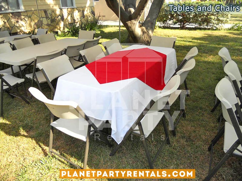 Rectangular Tables with Table Cloth and White Chairs