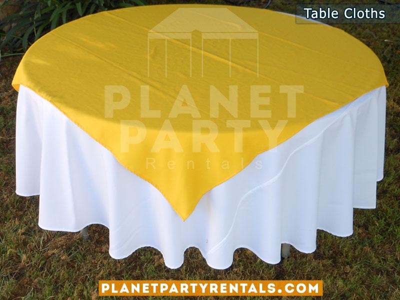 Round Table with White Table Cloth and Yellow BlueOverlay/Runner
