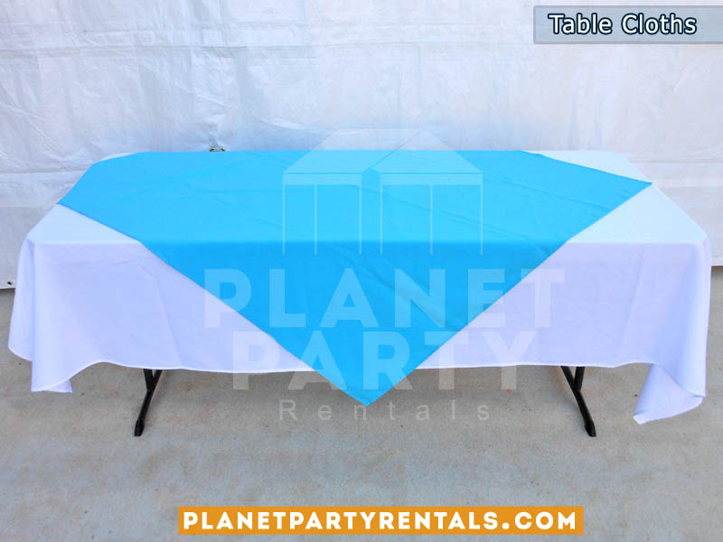 Rectangular Table with White Rectangular Table Cloth  and Light Blue Overlay/Runner