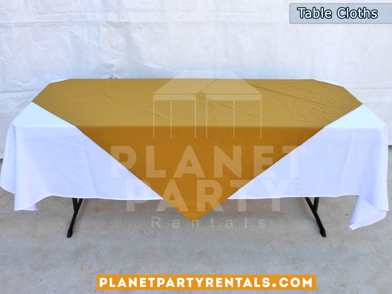 Rectangular Table with White Rectangular Table Cloth and Gold Overlay/Runner