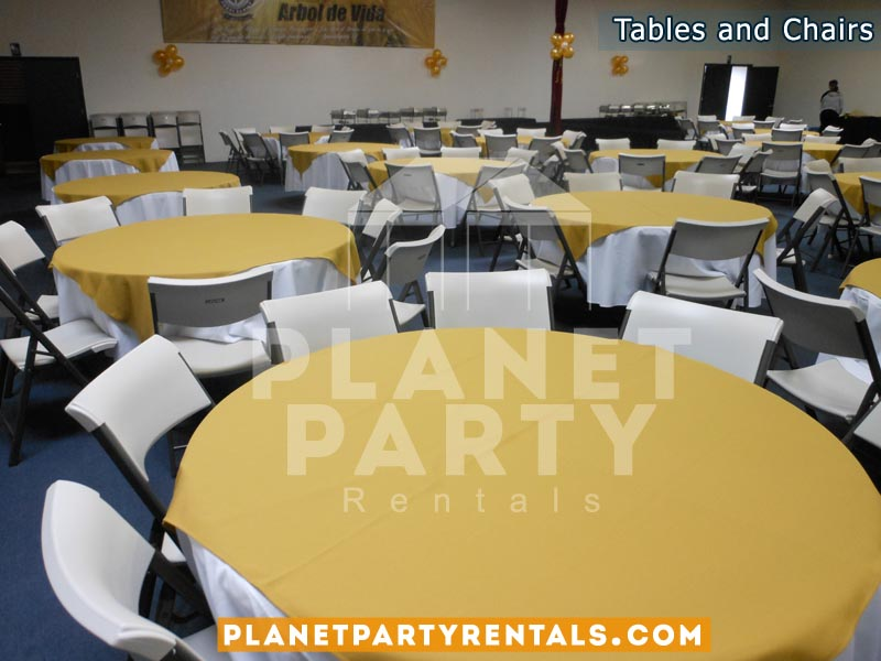 Round Tables with Table Cloth and White Chairs