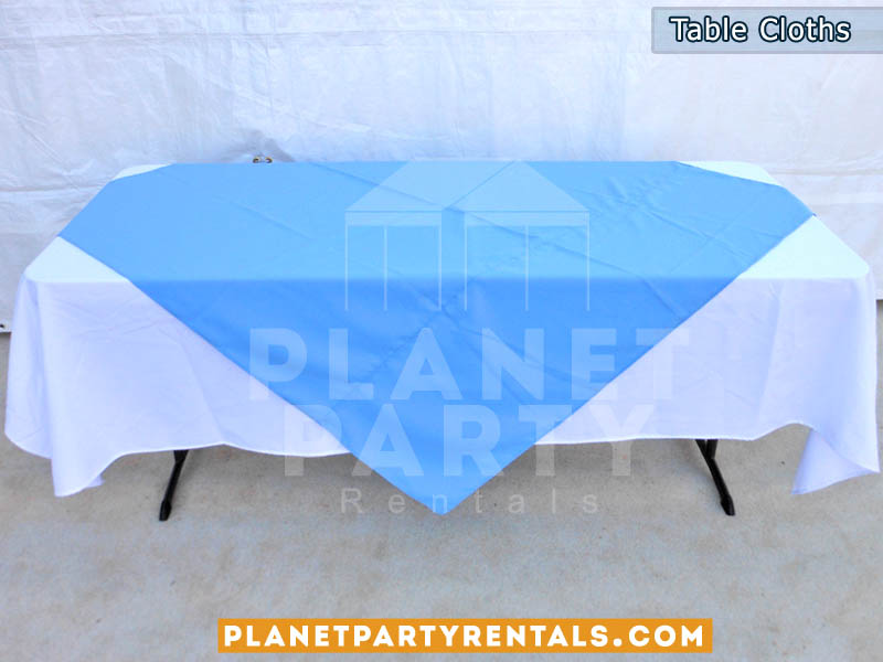 Rectangular Table with White Rectangular Table Cloth and Blue Overlay/Runner