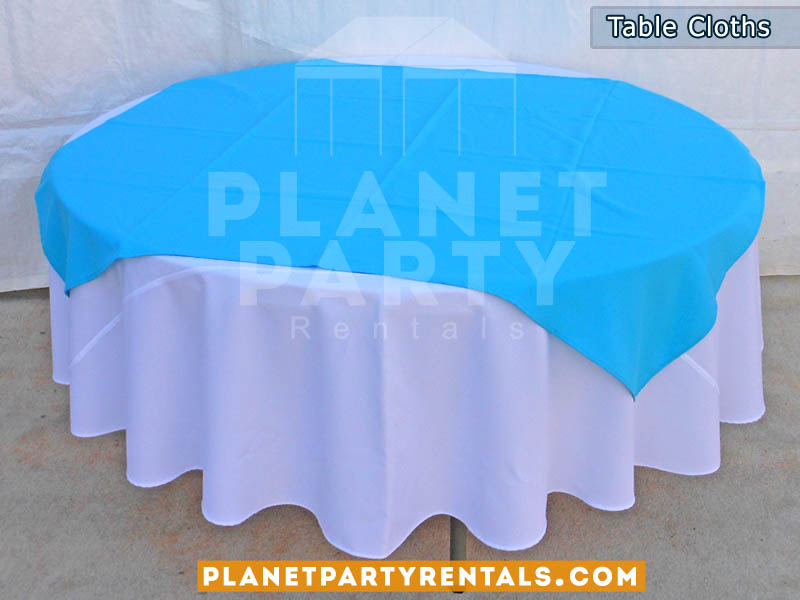 Round Table with White Table Cloth and Light Blue Overlay/Runner