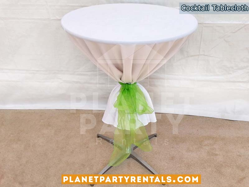 Cocktail Table with White Tablecloth and Green Bow