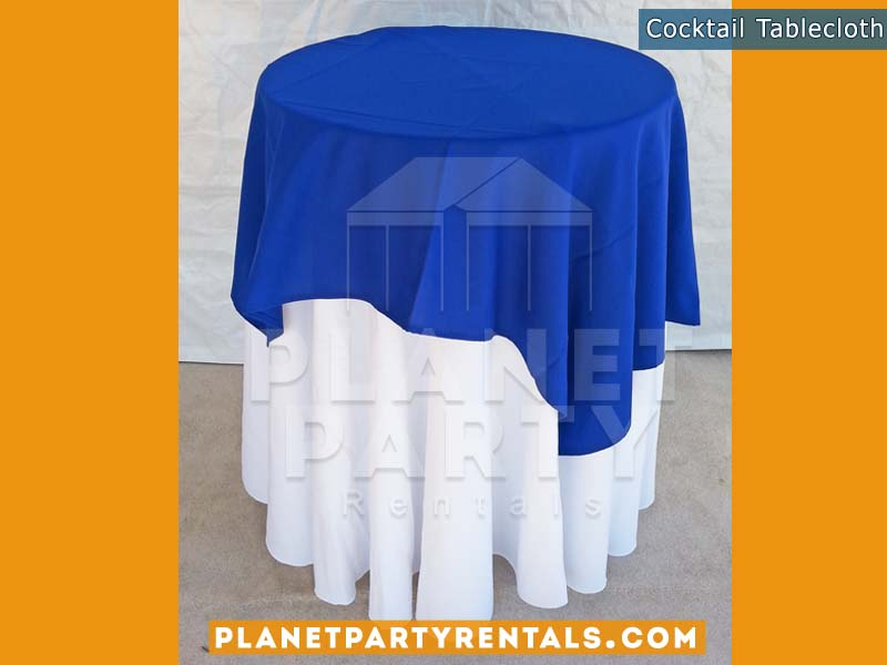Cocktail Table with White Table Cloth and Royal Blue Overlay/Runner | Linen Rentals