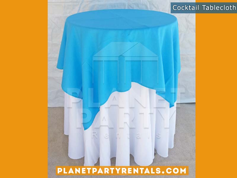 Cocktail Table with White Table Cloth and Light Blue Overlay/Runner | Linen Rentals