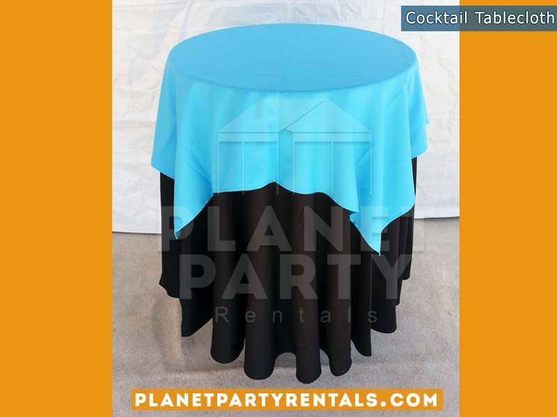 Cocktail Table with Black Tablecloth and Light Blue Overlay